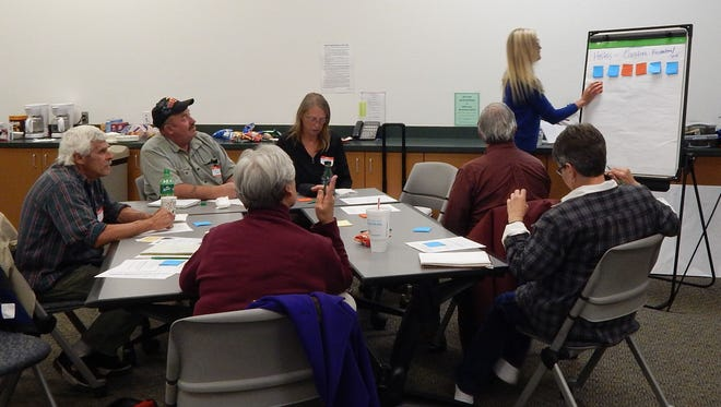 U.S. Forest Service employees from the Alamogordo and Ruidoso Ranger stations acted as facilitators in guiding residents to fill out forms that will be used in the assessment phase of the study.