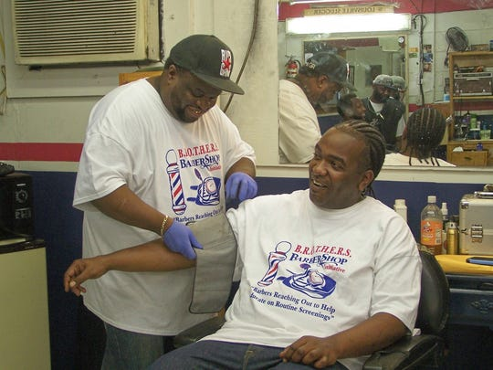 B.R.O.T.H.E.R.S. participant Sylvester Ellis takes the blood pressure of 34-year-old Antonio Murry. Murry, who lives in Itta Bena, has a normal blood pressure reading but has it checked often through the program.