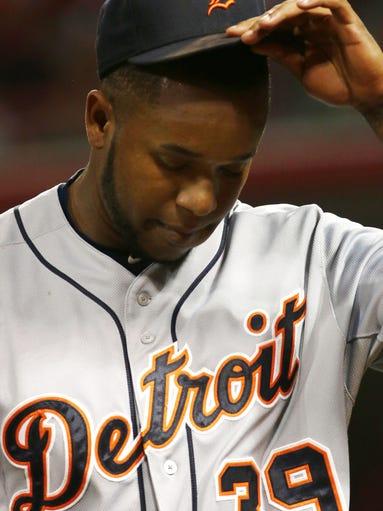 Detroit Tigers pitcher Neftali Feliz walks off the
