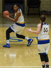 Castle's Jalaya Dowell (50) steals the ball during