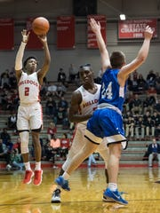 Bosse's Mekhi Lairy (2) makes a three-pointer as Bosse's