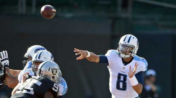 Aug 27, 2016; Oakland, CA, USA; Tennessee Titans quarterback Marcus Mariota (8) passes against the Oakland Raiders during the first half at Oakland-Alameda Coliseum. Mandatory Credit: Kirby Lee-USA TODAY Sports