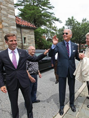 Beau Biden (left) and his father, Vice President Joe Biden, were together on Aug. 13, 2013, in Wilmington at St. Anthony of Padua Catholic Church in Wilmington for the funeral of the Rev. Roberto Balducelli, the longtime pastor. Beau Biden, who fell ill the next day from symptoms of the brain cancer that killed him Saturday, will have a public viewing Friday at the same church, and his funeral there Saturday.