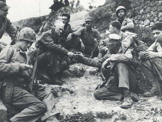 Ernie Pyle takes a break with some Marines on Iwo Jima