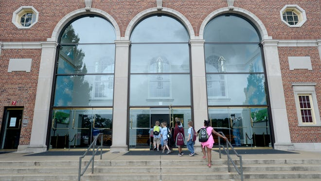 Third Grade Academy students enter the Civic Hall Performing Arts Center in July.