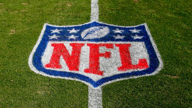 In this Nov. 4, 2018 file photo, the NFL logo is displayed on the field at the Bank of American Stadium before an NFL football game between the Tampa Bay Buccaneers and the Carolina Panthers in Charlotte, N.C. The NFL revealed Sunday, Aug. 23, 2020, that several positive COVID-19 tests were found a day earlier by one of its testing partners, and the Chicago Bears said they had nine false positives.