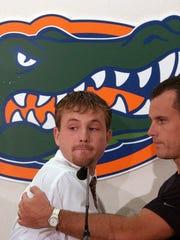 Teddy Dupay, left, receives a hug from Florida basketball