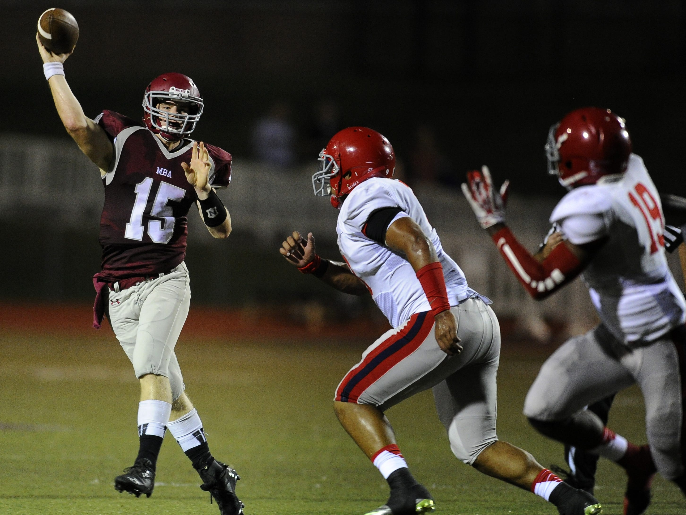 Montgomery Bell quarterback Cole Euverard (15) throws a pass past the Brentwood Academy defense during their game Friday Sept. 20, 2013, in Nashville, Tenn.