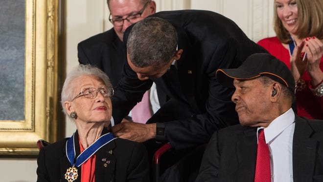 US President Barack Obama presents the Presidential Medal of Freedom to NASA mathematician and physicist Katherine Johnson at the White House in Washington, DC, on November 24, 2015.