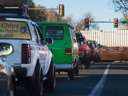 Evening traffic waits to proceed northbound on Lemay Avenue as a train crosses Vine Drive in October. The city of Fort Collins is considering whether to build an overpass as part of a road realignment to ease congestion.