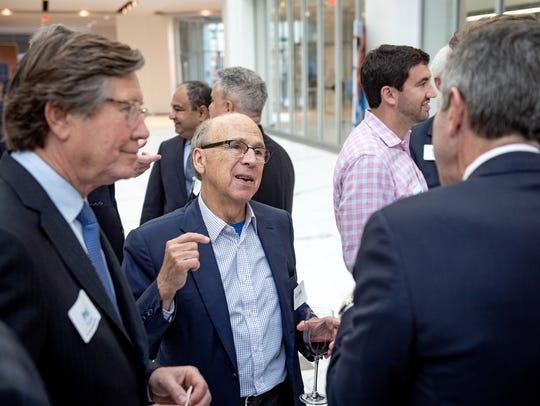April 18, 2018 - AutoZone founder Pitt Hyde, center,
