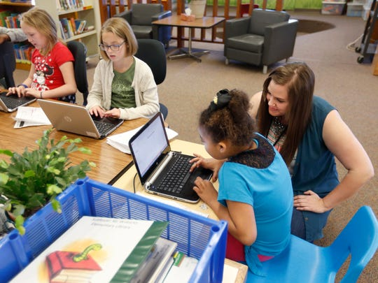 Third grade teacher Joyce Burns helps Deseray Wise with her research project as, from left, Zaydence Riley, Emmie Setliff and Breklyn O'Neal work in the library on Thursday, Apr. 28, 2016 at William Elementary.