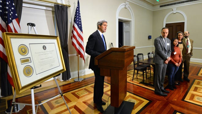 Secretary of State John Kerry honors members of the Coalition of Immokalee Workers at a White House ceremony Thursday.