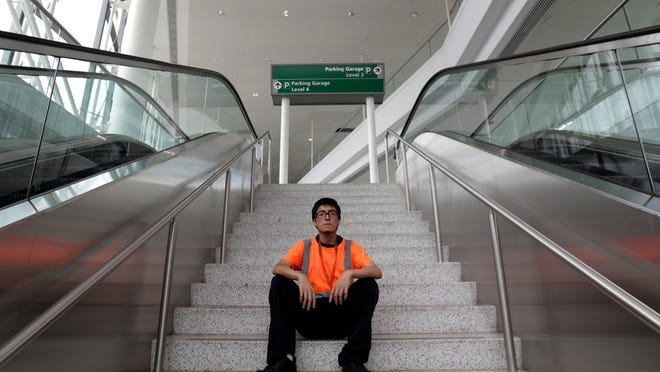 Irwin Carbajal, 23, an aircraft cabin cleaner, seen Thursday at Newark Liberty International Airport, makes $8.25 an hour and hopes to benefit from a pay increase ordered by the Port Authority of New York and New Jersey.
