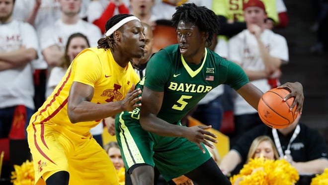 Baylor forward Johnathan Motley drives around Iowa State forward Solomon Young, left, during the second half of Saturday's game in Ames, Iowa. (AP Photo/Charlie Neibergall)