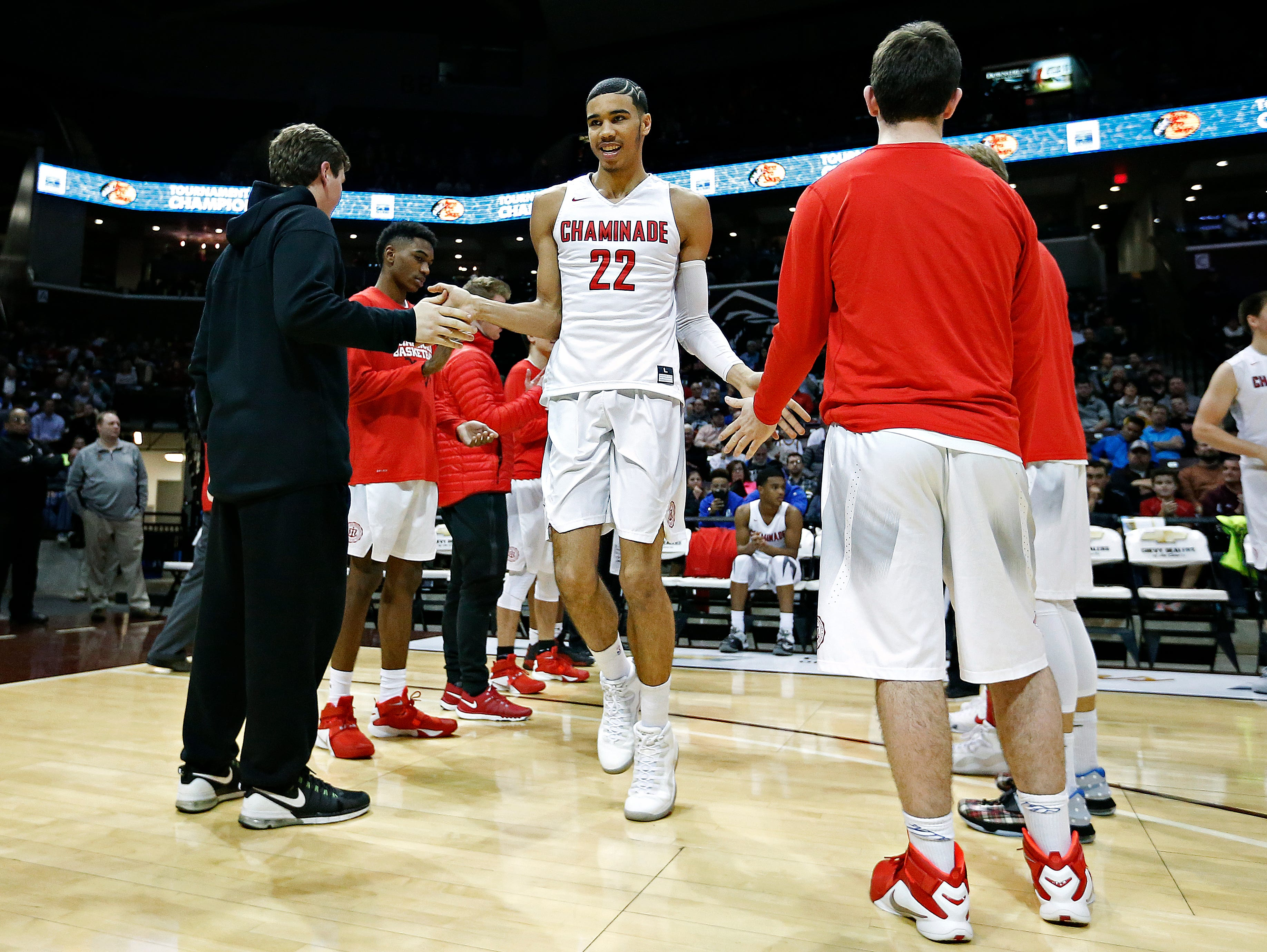 Chaminade College Preparatory School forward Jayson Tatum (22) enter the court prior to the start of the 2016 Tournament of Champions first round game between Chaminade College Preparatory School (St. Louis, Mo.) and Christ The King High School (Middle Village, N.Y.) at JQH Arena in Springfield, Mo. on Jan. 14, 2015. The Chaminade Red Devils won the game 67-48.