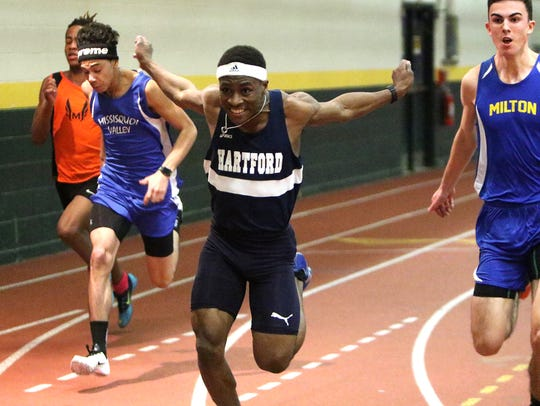 Hartford's Abayomi Lowe crosses the finish line and