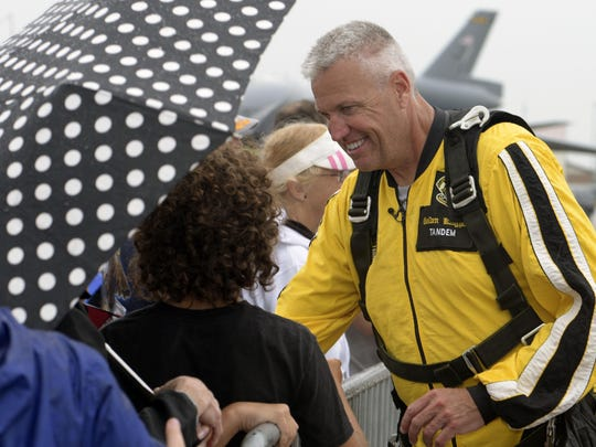 Buffalo Bills head coach Rex Ryan meets with fans after he jumped 12,500 feet above Niagara Falls Air Force Base with the United States Army Golden Knights Parachute Team on July 17, 2015.
