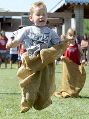 Miles Wells, 5, concentrates as he takes first place in his age group in the sack race.