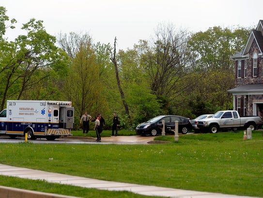 In this file photo from May 6, 2015, an ambulance idles