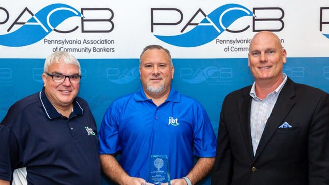 Jonestown Bank & Trust Co. has been recognized by the Pennsylvania Association of Community Bankers for its commitment to local community service. Pictured with the award are, from left, Lloyd Deaven Jr., JBT director; Ed Martel,Jr., senior vice president, sales, marketing and branch administration; and Troy Peters, president and CEO.