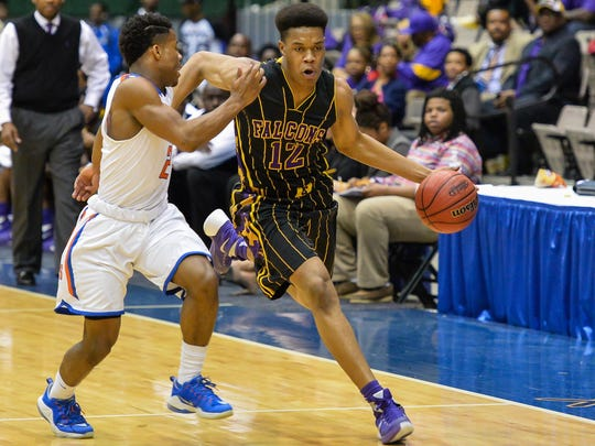 Columbus' Robert Woodard drives the ball up the floor against Southhaven during Boys MHSAA 6A Semifinal play at the Mississippi Coliseum in Jackson.