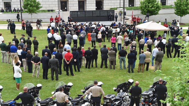 A large crowd listens to Attorney General Jim Hood Tuesday evening during the Fifth Annual Mississippi Fallen Law Enforcement Officers Candlelight Vigil at the State Capitol Mall in Jackson. Attorney General Hood and Mississippi Association of Chiefs of Police hosted the event. Seven officers from Mississippi have lost their lives since last year's ceremony.