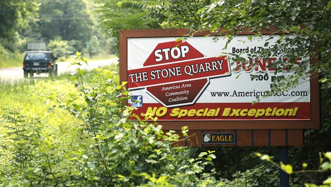 A Stop the Stone Quarry billboard in 2014.
