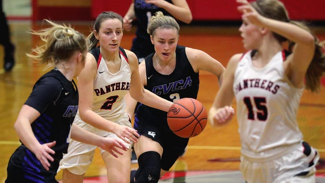 Manchester's Karli Anker, left center, takes the ball down the court through traffic during the second half of a game in January.