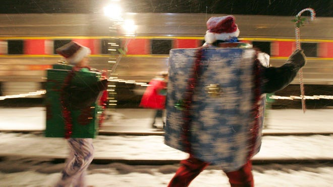 Elves dressed as presents dance for the children on the Cuyahoga Valley Scenic Railroad Polar Express.