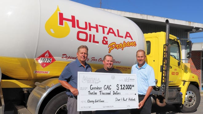 Paul, Evan and Dave Huhtala hold an oversized check representing Huhtala Oil and Propane's donation to the Gardner Community Action Committee. Paul and Dave Huhtala decided last winter to end their annual Huhtala Oil Charity Golf Tournament after a 25-year run, but with so many people affected by the economic impact of the coronavirus pandemic, the brothers elected to once again make a donation to the Gardner CAC of the same amount annually genereated by the tourament.