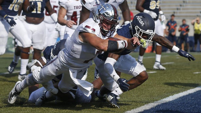 Troy quarterback Kaleb Barker dives into the end zone to score against Akron during their 2019 game. Barker, a backup last season, has taken over starting duties for the Trojans this year.