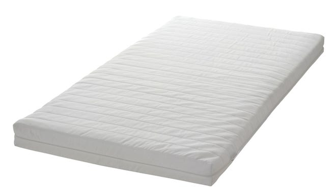 This undated photo shows the Ikea VYSSA style crib mattress that is being recalled because it could create a gap between the mattress and crib ends larger than allowed by federal regulations, posing an entrapment hazard to infants.
