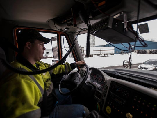 VTrans Journeyman Andre Fontaine drives a plow truck down Vermont 15 in Colchester on Thursday, Feb. 9, 2017. A tracking system installed in the truck allows supervisors to see where Fontaine plows and how much salt he is using. The department uses that data to plan in real-time during snow storms.