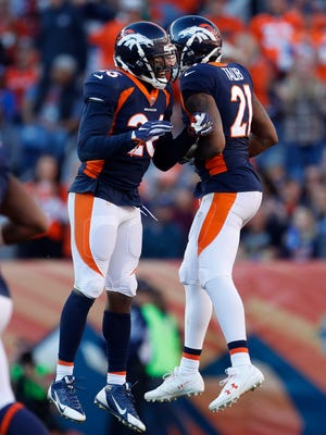 Denver Broncos free safety Darian Stewart (26) celebrates his interception against the New York Jets with cornerback Aqib Talib (21) during the first half of an NFL football game, Sunday, Dec. 10, 2017, in Denver. (AP Photo/Joe Mahoney)
