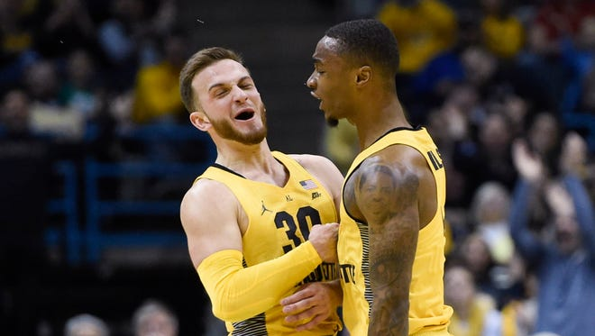 Marquette guard Andrew Rowsey (left) had a big game against DePaul earlier in the season.