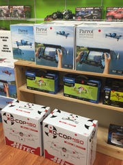 Flying drones fill a shelf in the upstairs showroom