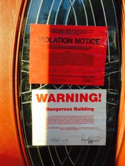 Spring Valley Building Department's fire inspector notices declaring the 3-story house at 29 Collins Ave. uninhabitable in the aftermath of an Oct. 24, 2014, fire. The fire erupted in the attic and left seven families with 21 people homeless. The notices are seen Oct. 27, 2014.