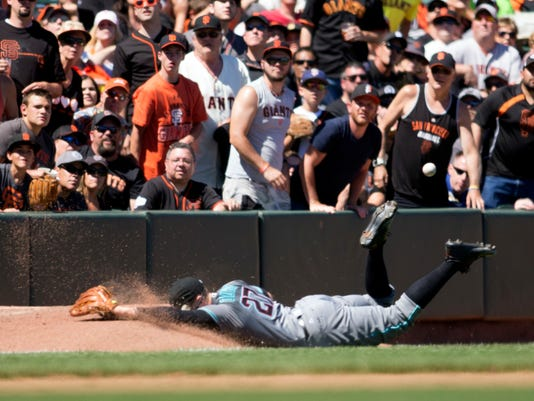 Arizona Diamondbacks' Brandon Drury can't make a diving catch of a foul popup in the bullpen during the sixth inning of a baseball game against the San Francisco Giants on Saturday, July 9, 2016, in San Francisco. The Giants won 4-2. (AP Photo/D. Ross Cameron)