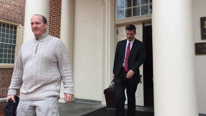 Christopher Story (left), a former Georgetown police officer, and Bruce Rogers, an attorney representing him, leave the Delaware Supreme Court on Wednesday. Story and another former Georgetown officer are appealing to the Delaware Supreme Court to rule for them in a lawsuit over their complaints about the police department.