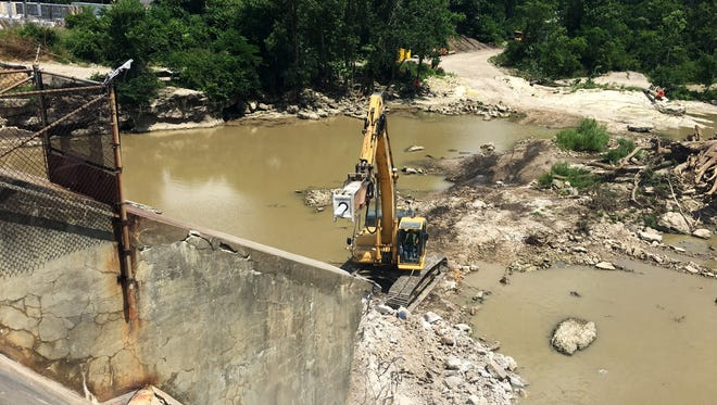 Demolition of the 105-year-old Ballville Dam started July 2. Fremont City Council approved a $309,968 payment to MWH Constructors Thursday for work done on the removal project.