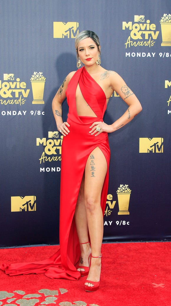 Singer Halsey matched the carpet.