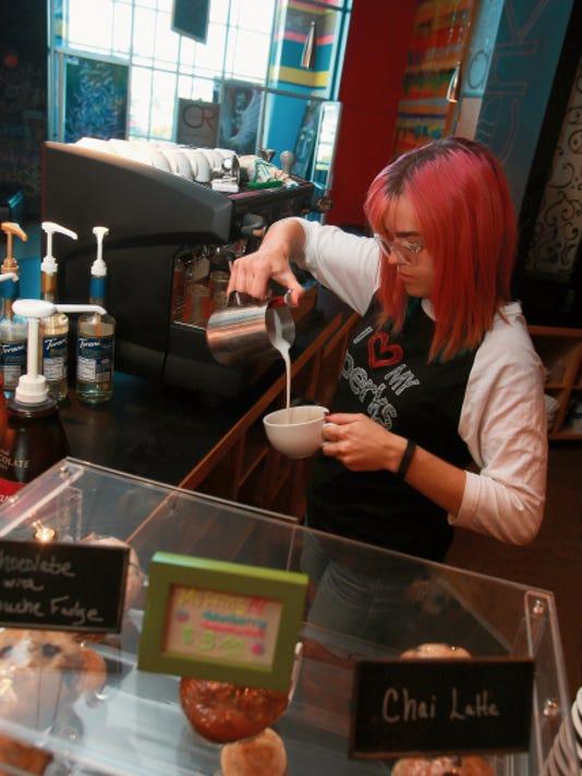 VICTOR CALZADA-EL PASO TIMES Haley Houston prepares a drink at the Perks Coffee bar inside Life Church at 1580 Joe Battle Blvd.
