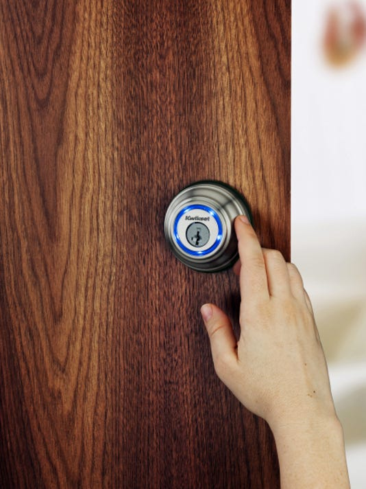 This photo provided by Kwikset.com shows the company's Kevo lock, a Bluetooth-enabled deadbolt that turns your smartphone into an electronic key. Kevo locks and unlocks with the touch of a finger while your smartphone remains in your purse or pocket. Kevo owners can send eKeys to others through the Kevo app, and delete them at any time. (Kwikset.com via AP)
