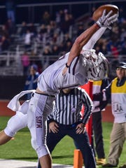 Milford's Brendan Perrett makes one of his two touchdown