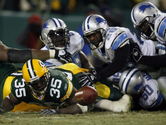 The Green Bay Packers #35 Samkon Gado drops a forward pass to escape a safety call against the Lions in the 4th quarter as the Packer beat the Lions 16 to 13 in overtime in Green Bay Wisconsin Sunday, Dec. 11, 2005 at Lambeau Field. DAVID P. GILKEY/Detroit Free Press