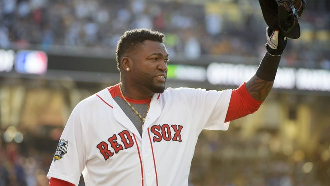David Ortiz tips his helmet to the crowd as he is replaced in the third inning.