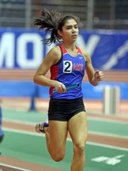 Carmel's Jade Sessions competes in the girls 4x800