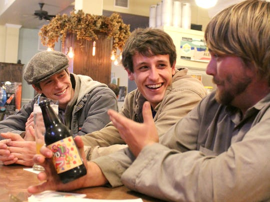 From left: Jesse Arnold, Grant Summers and Jonathan Barnes have a couple of cold ones at the Playalinda Brewing Company in Titusville. All three shared what it's like to be young and single in Brevard County.