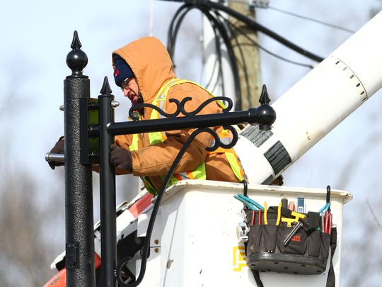 Joe Ping from Croton, works in a bucket-truck replacing the support arms of the street lights in New City on Friday, Feb. 12, 2016.